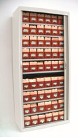 Fleximedical Freestor side tambour. 2007mm (h) x 1000mm (w) 9 levels with boxes (54 boxes in total)